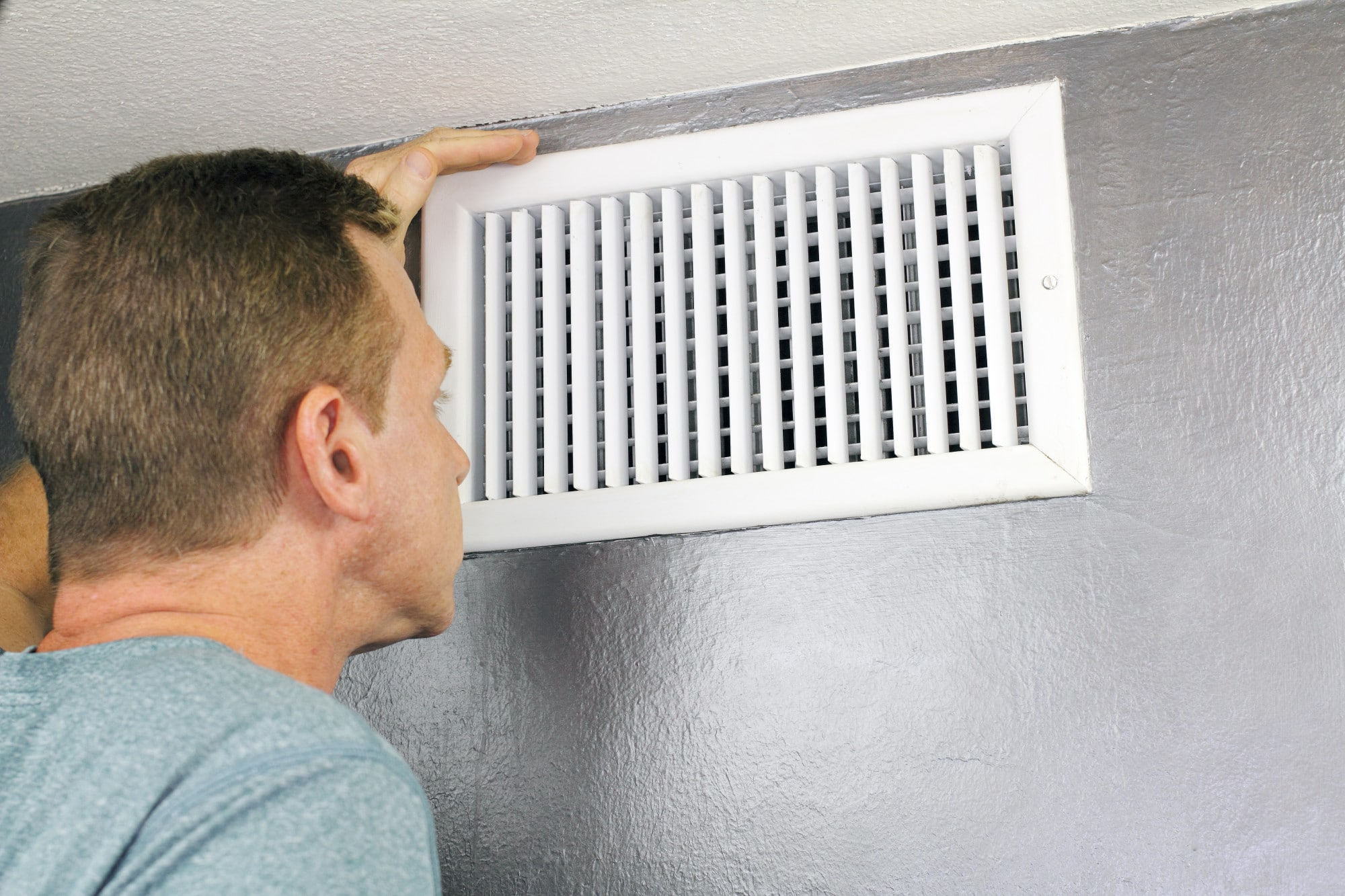 Inspecting a Home Air Vent for Cleaning and Maintenance